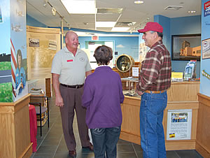 NHAHS volunteer Don Bourassa guiding some visitors through the museum on a recent Saturday.